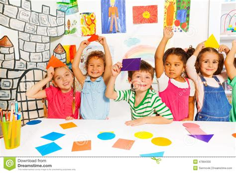 where are the people of color in childrens books the happy little kids with color cardboard shapes stock photo