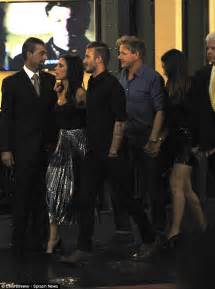 David Beckham slips a romantic arm around Victoria during