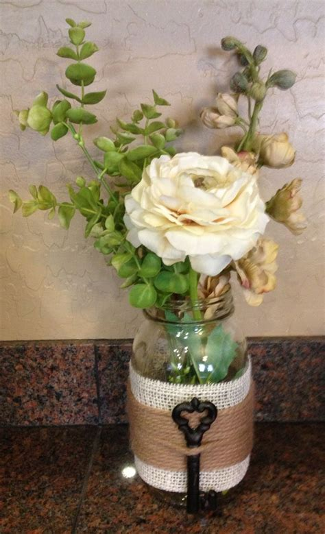 embellished mason jar craft i made with floral arrangement