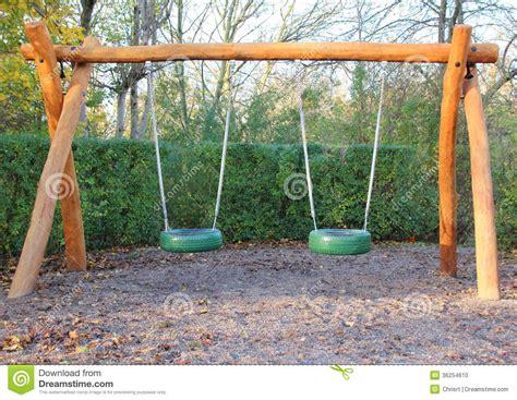 school playground swings double swing at public school playground stock photo