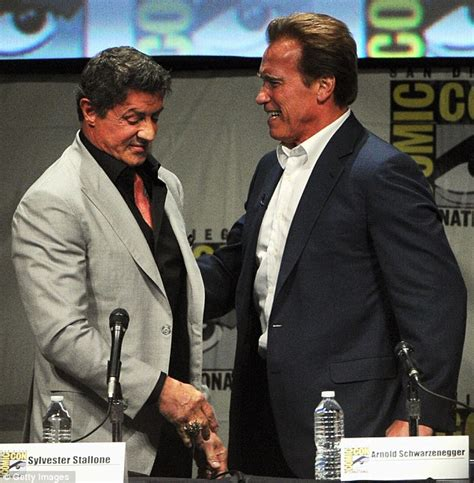 sylvester stallone bench press san diego comic con 2012 arnold schwarzenegger gives old