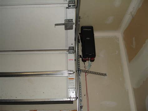 Garage Door Bar by Torsion Bar Garage Door Opener Neiltortorella