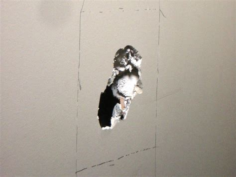 fix hole in wall how to repair cracks and holes in drywall how tos diy