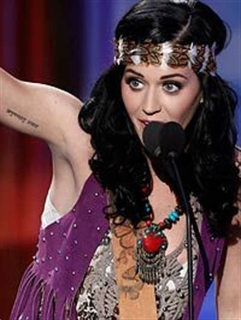 katy perry pin up tattoo placement quot no regrets just love quot in sanskrit on right