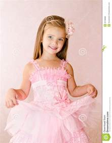 Portrait of cute smiling little girl in princess dress royalty free