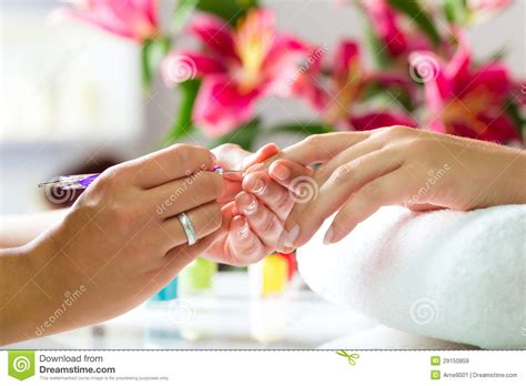 nail salon manicure woman in nail salon receiving manicure stock image image