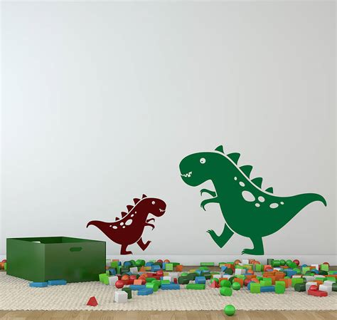 dino wall stickers friendly pair of dino dinosaur wall stickers by snuggledust studios notonthehighstreet
