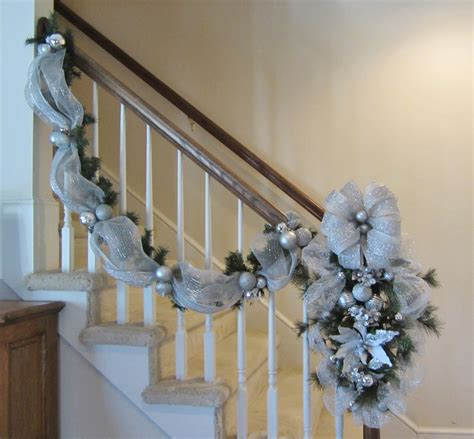how to decorate banister with garland christmas stair case garland swag wreath stairway