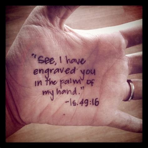 bible verse tattoo on hand written on the palms of his hands one passion one devotion