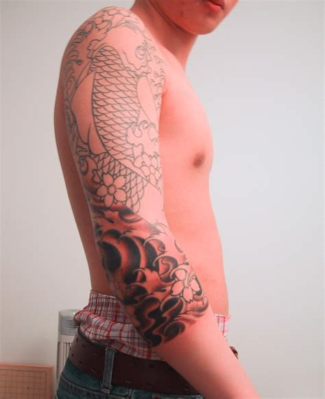 designs around tattoos koi wrapped around the sleeve