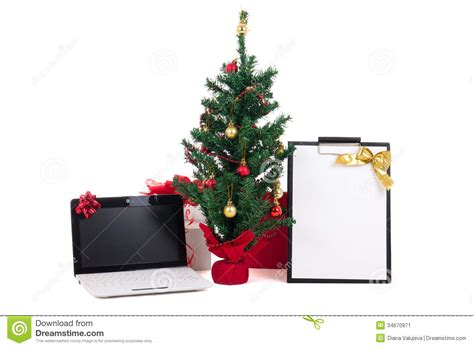 decorated christmas tree computer and gift list on white