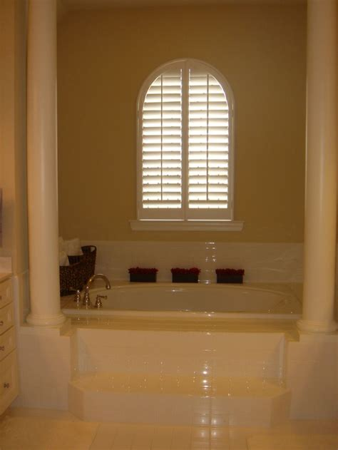 bathroom window louvers 17 best images about arched plantation shutters on