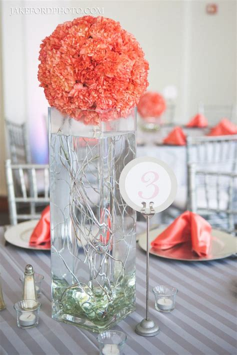 chic photos of stunning tall coral wedding centerpieces