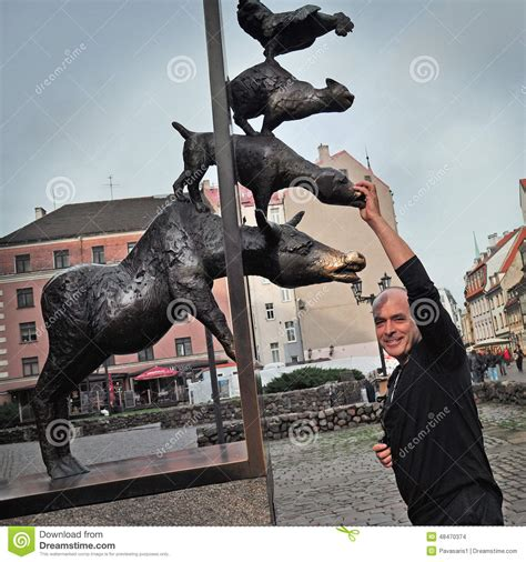 House Architecture Styles statue of the bremen town musicians in riga stock photo