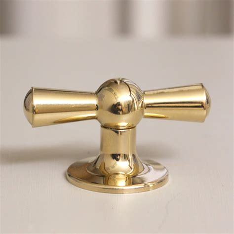 Brass Cabinet Pulls And Knobs by Crossed Cabinet Knob Brass