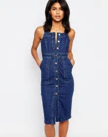 Dress Denim catches the eye in fitted denim dress as she
