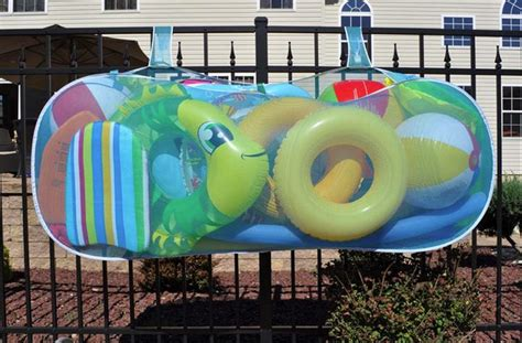Hanging Pool Float Rack by Jeri S Organizing Decluttering News Summer Organizing The Pool Toys