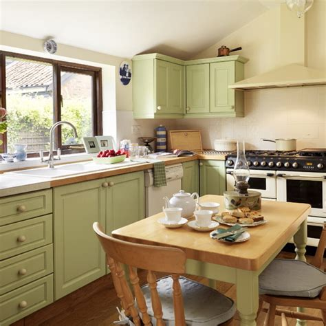 green kitchen is perfect choice for a kitchen wall and the summer palette choices of green and brown for all