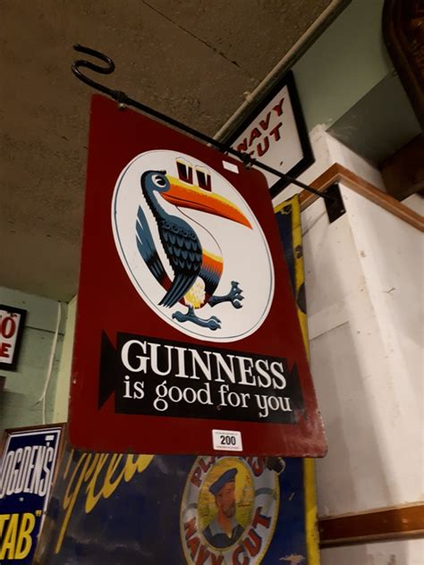 Auction Alert Own A Of Guinnesss Wardrobe by Guinness Is For You Sided Enamel Advertisement