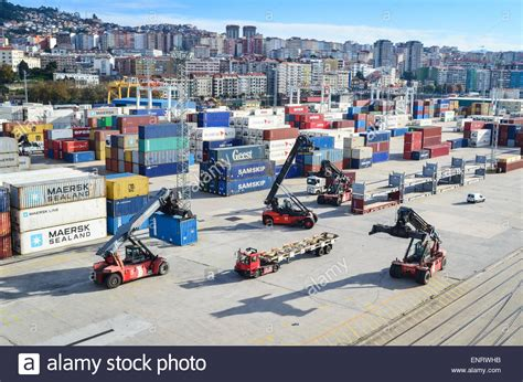 Vigo Container cargo handling forklifts at the container terminal of the port of stock photo royalty free