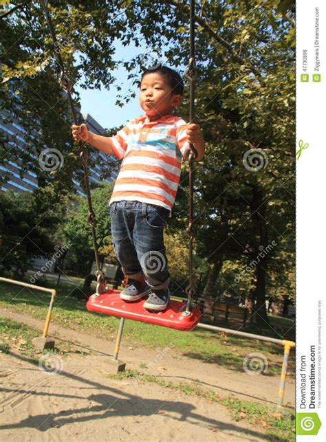 swing years japanese boy on a swing stock photo image 47730898
