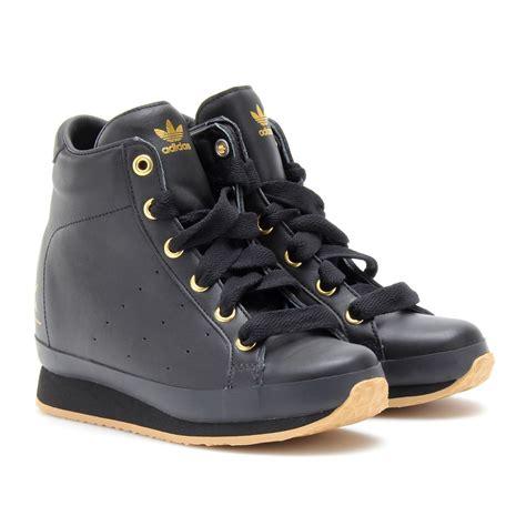 adidas wedge sneakers teewhy hive rihanna in nike rally camo hoodie and adidas