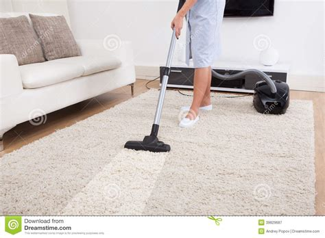 how to vacuum carpet maid cleaning carpet with vacuum cleaner stock photo