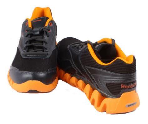 reebok zigtech zigactivate unisex youth black orange