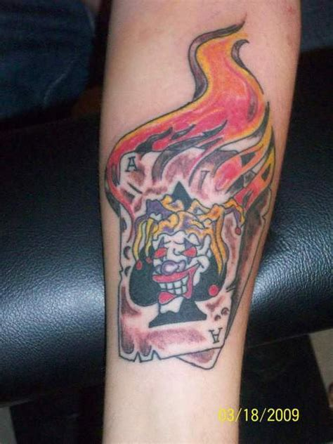 joker tattoo on leg burning joker tattoo on leg