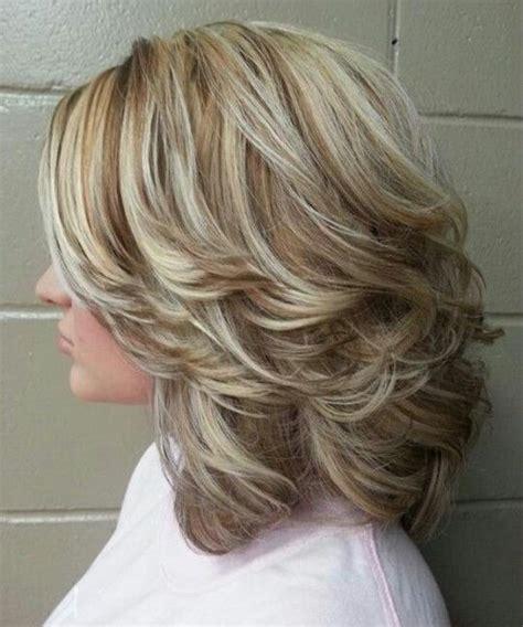 layered beachy medium length haircut 17 best ideas about medium length wavy hairstyles on