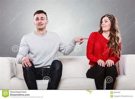 couch dating shy woman and man sitting on sofa first date stock photo