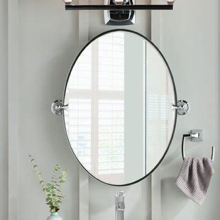 traditional brown and gold guest bathroom with oval mirror bathroom mirrors you ll love wayfair