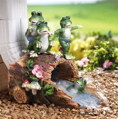 decorative downspout group of frog children on log decorative garden downspout