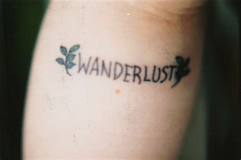 tattoo wrist wanderlust wanderlust tattoologist