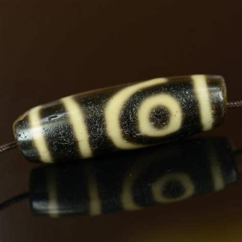 2 eyed dzi bead meaning tibetan two dzi bead genuine antique dzi bead