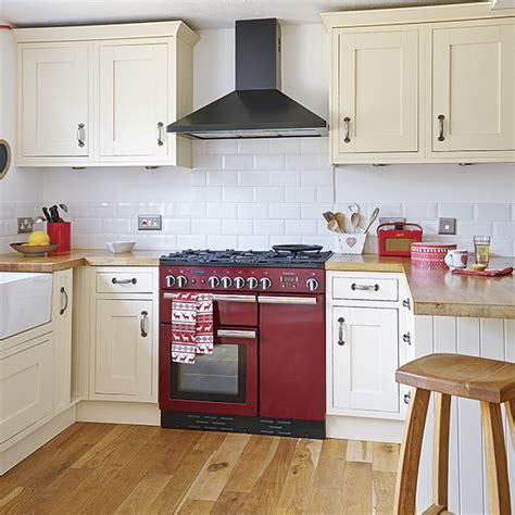 country kitchen with range cooker housetohome co uk shaker style kitchen with red range cooker 1900s cottage
