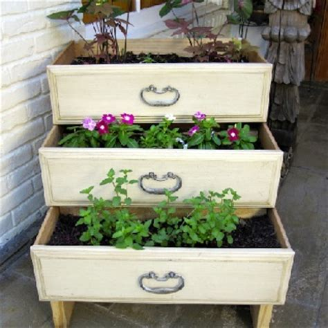 three stacked dresser drawers create a planter with