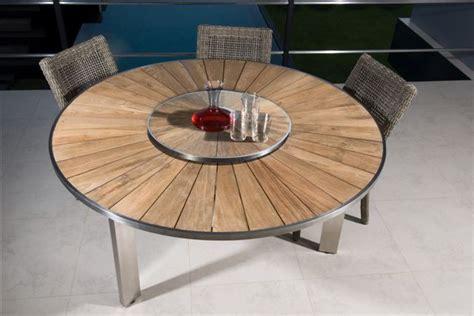 Délicieux Table Et Chaises De Jardin En Fer #5: photo_d_ambiance_table_ronde_en_teck_et_inox_1332858769_3_1_12.jpg