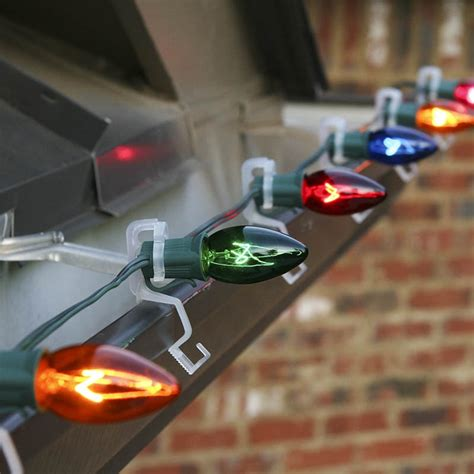 best christmas light hangers how to hang lights on gutters