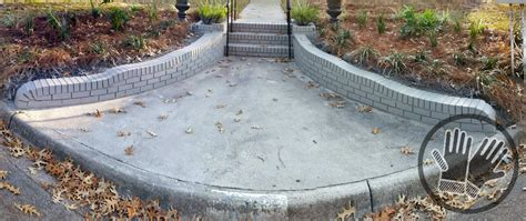brick retaining wall and steps painted with behr elephant skin