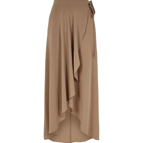 river island beige wrap front midi skirt in lyst