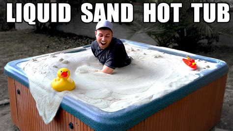 guys in bathtubs watch this guy swim in a liquid sand hot tub
