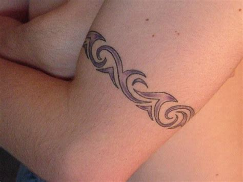 tribal tattoos around bicep tribal owl pictures best design ideas