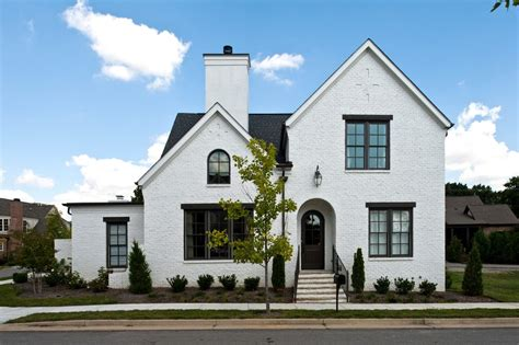 white house with black windows black window trim exterior exterior traditional with white