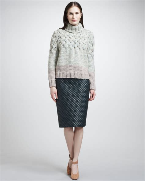 chunky turtleneck sweater quilted leather skirt