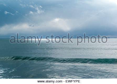 light across the ocean horizons over water stock photos horizons over water