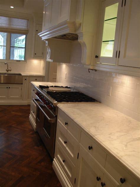 white kitchen patterned floor wood herringbone floor transitional kitchen designer