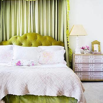 green tufted headboard beds in front of window contemporary bedroom greg natale