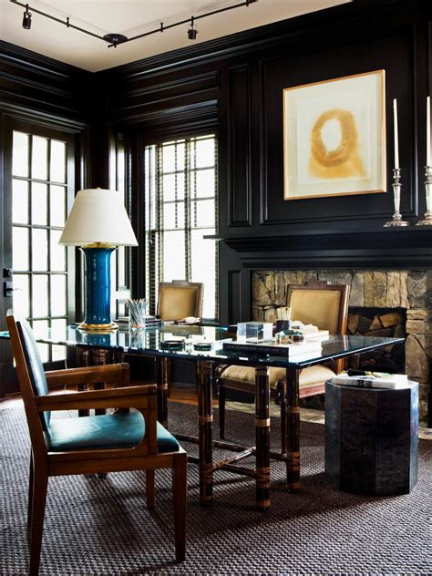 manhattan medicine cabinet company glass topped desk in black wood paneled home office hgtv
