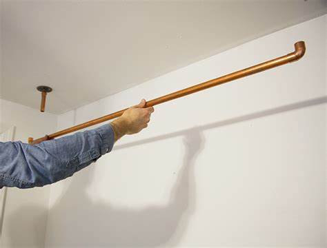 Hanging Clothes Rod From Ceiling by Hanging Copper Pipe Clothing Rack Diy A Beautiful Mess